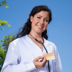 Pictured is a healthcare professional with a debit card illustrating one of the ways you can get compensated for taking healthcare surveys.